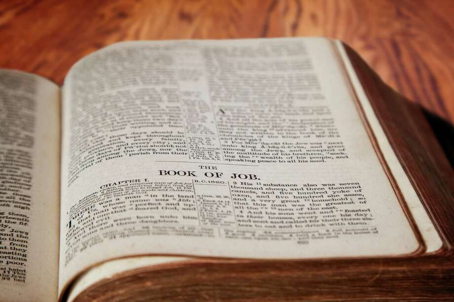 Closeup of an old Holy Bible opened to the famous Book of Job. Photo: Dreamstime / (c) Ronniechua   Dreamstime.com