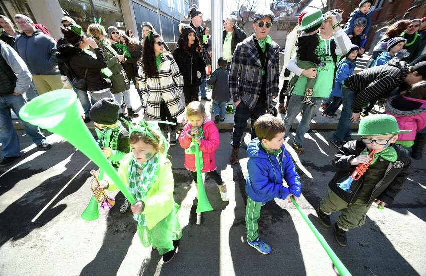 Children watch the New Haven St. Patrick's Day Parade on Chapel Street in 2018.