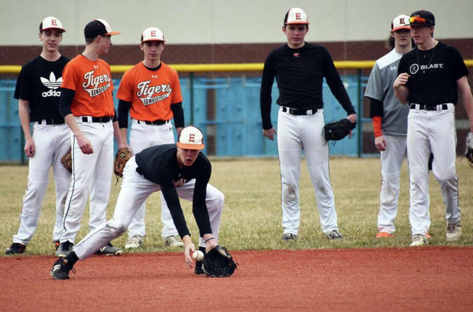 Edwardsville infielders run through fielding drills during practice Monday on the junior varsity field inside the District 7 Sports Complex. Photo: Matt Kamp|The Intelligencer