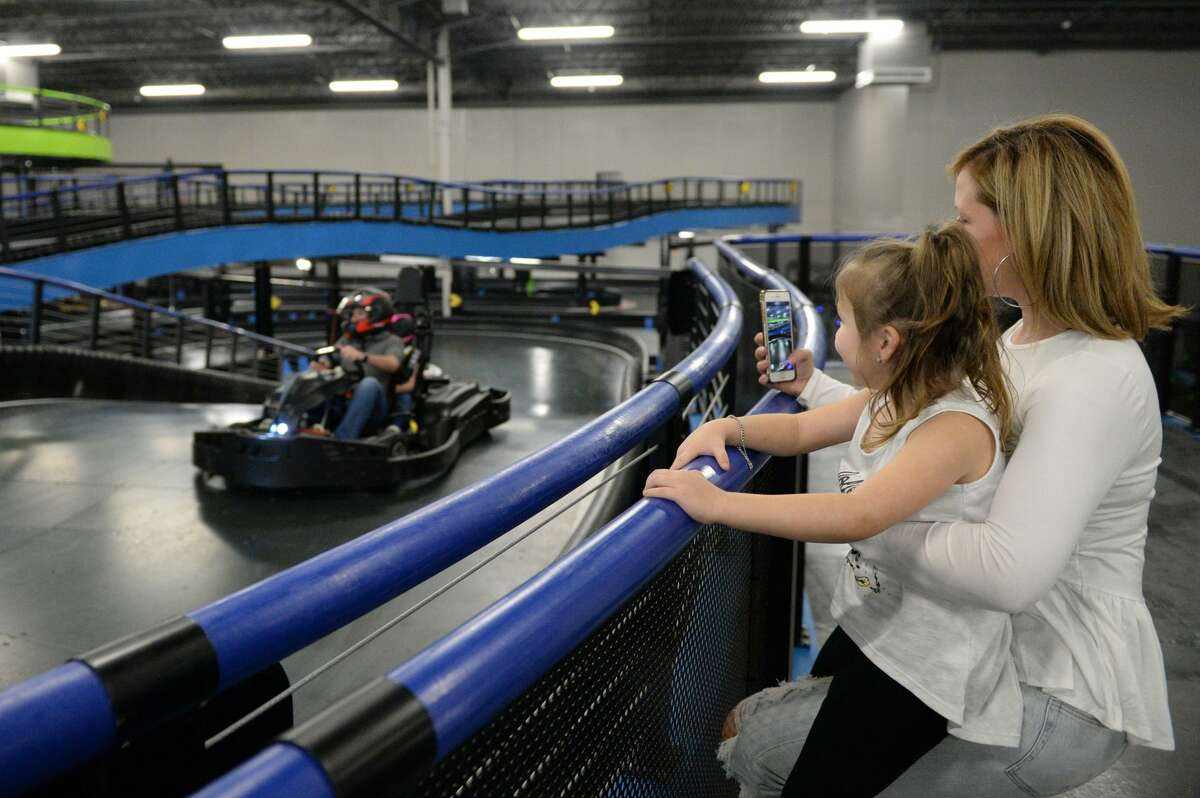 Giulliana Vieira, 4, and her mother Sarah watch family members Carlos and Isabella Vieira race at Andretti Indoor Karting & Games, Katy, TX on Monday, March 2, 2020.