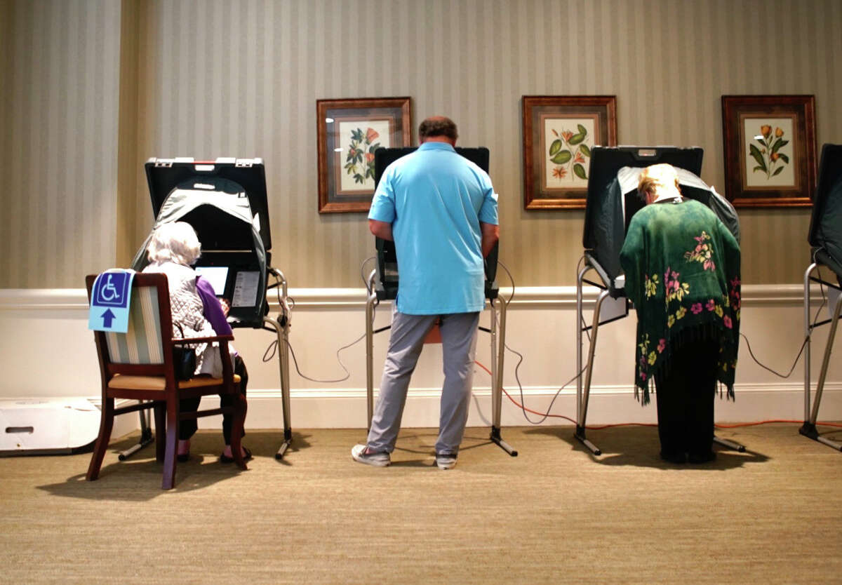 People cast their ballots, Tuesday, March 3, 2020, at The Village of Tanglewood voting site.