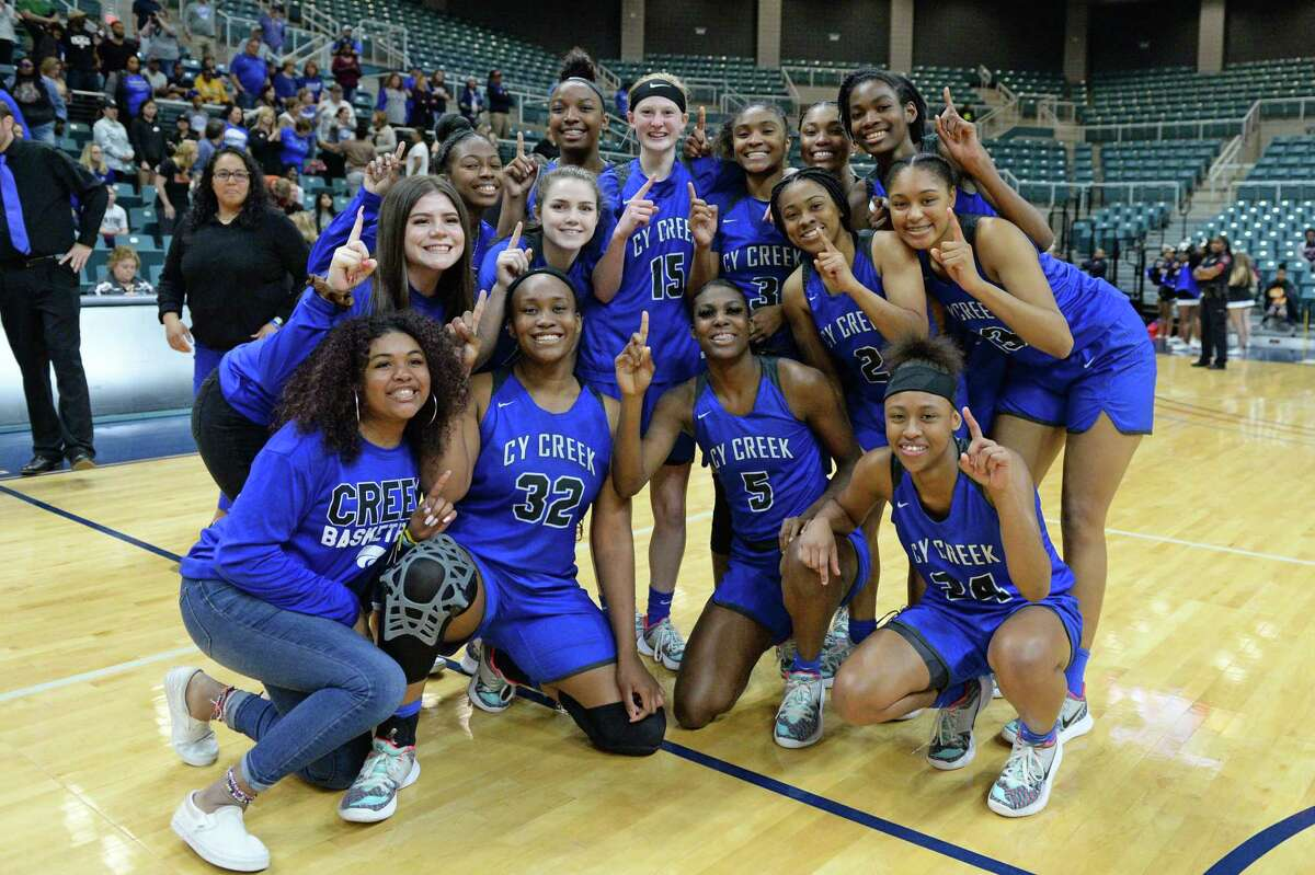 The Cy Creek Cougars celebrate their 60-40 victory over the Clear Springs Chargers in the Girls Region III-6A championship game on Saturday, February 29, 2020 at the Leonard Merrell Center, Katy, TX.
