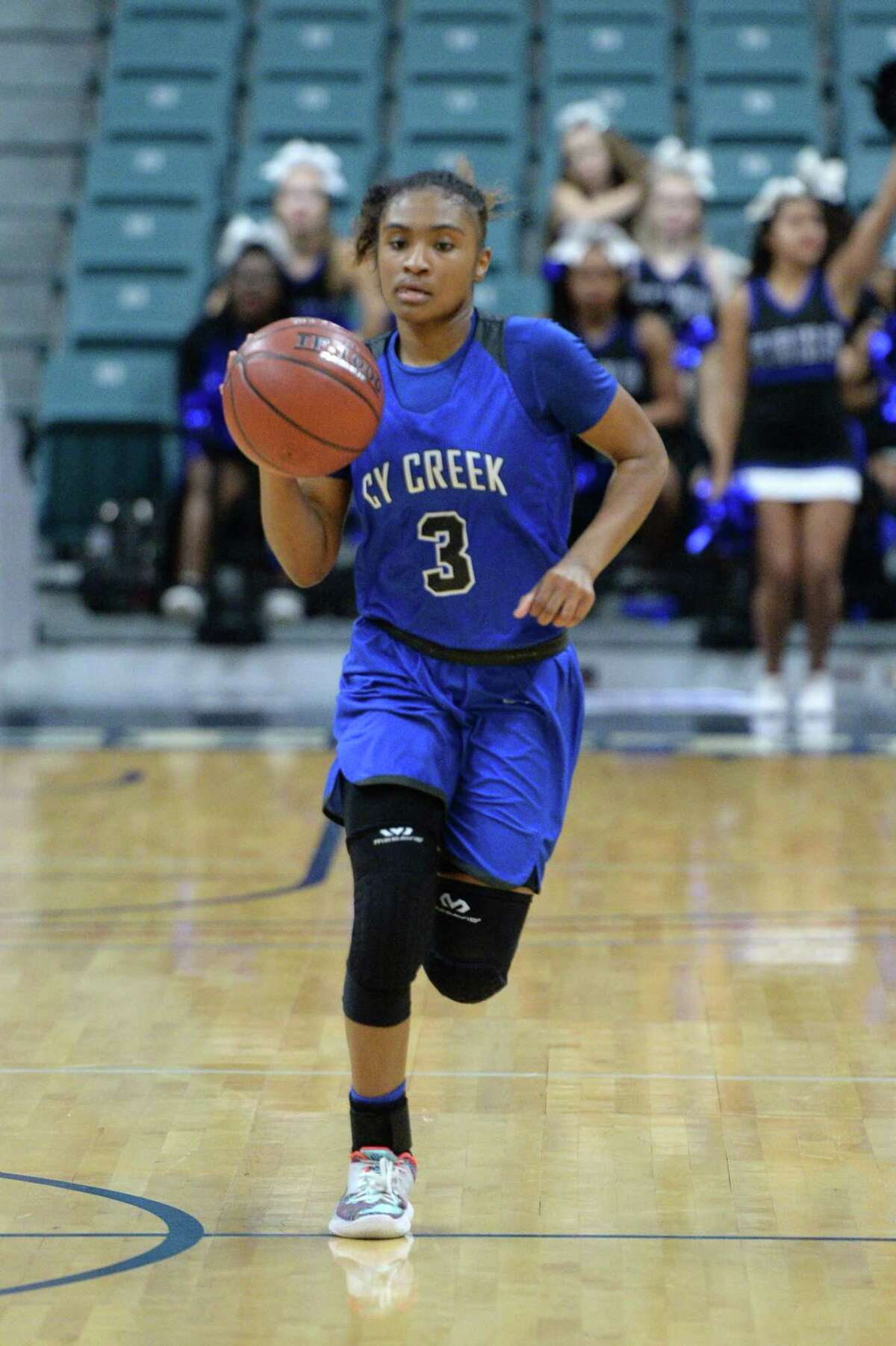 Rori Harmon (3) of Cy Creek dribbles past mid-court during the third quarter of a Girls Region III-6A championship between the Cy Creek Cougars and the Clear Springs Chargers on Saturday, February 29, 2020 at the Leonard Merrell Center, Katy, TX.