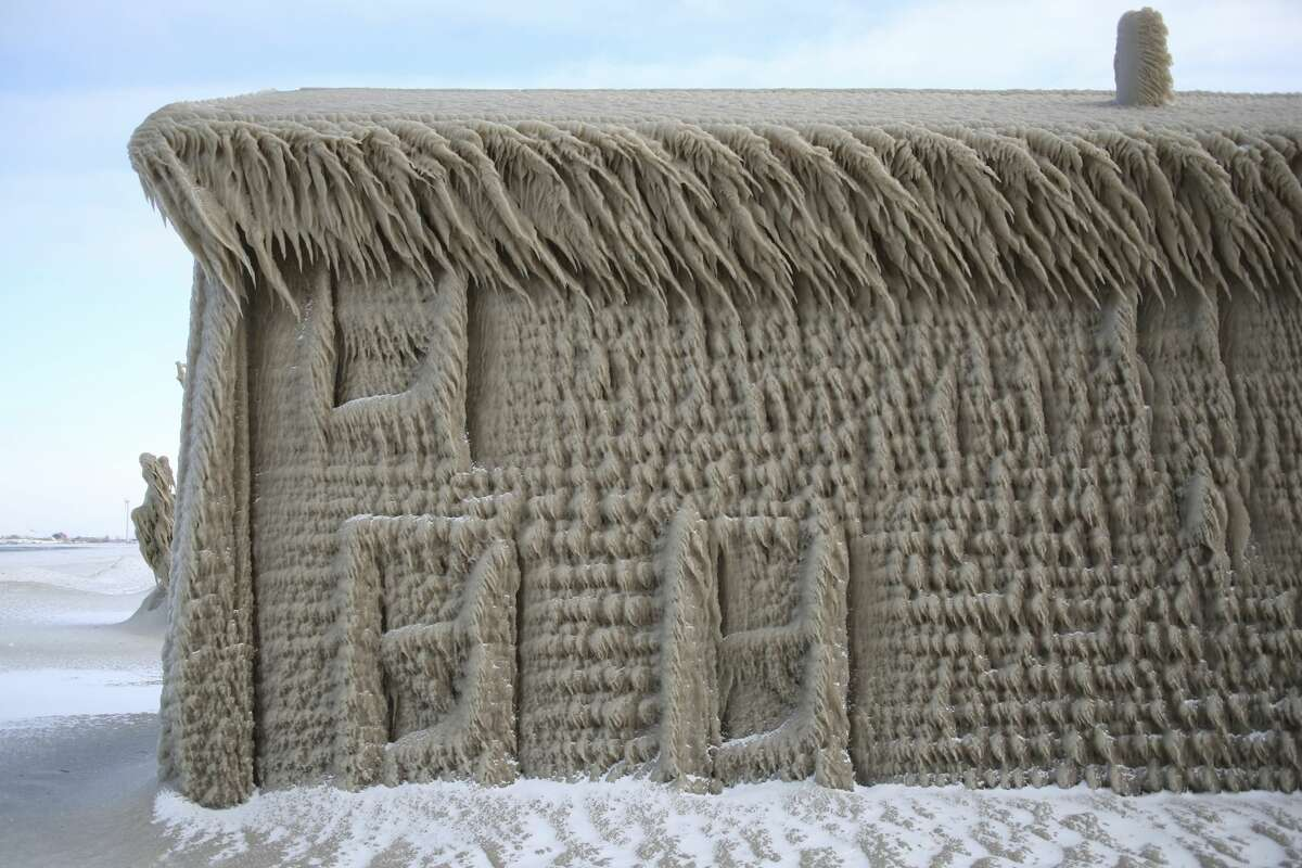 A house along Hoover Beach is covered by ice from high winds, Saturday, Feb. 29, 2020, in Hamburg N.Y. Blowing snow has fallen around the state since Thursday, though the heaviest snowfall was concentrated in largely rural areas east of Lake Erie and Lake Ontario. (AP Photo/Jeffrey T. Barnes)
