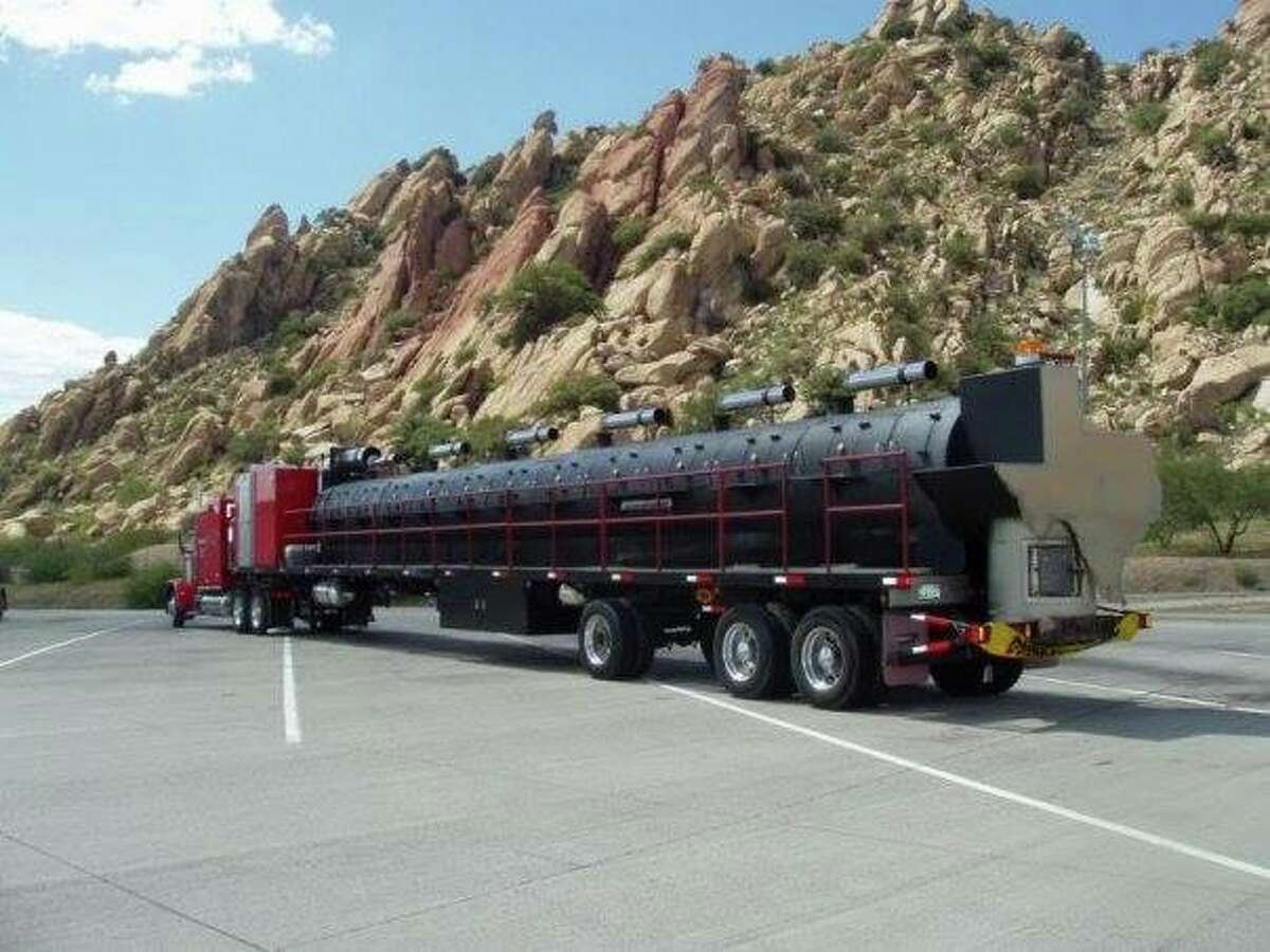 The rig is 76-foot long, and weighs 80,000 lbs. Terry Folsom said the barbecue grill/pit trailer is the largest mobile smoker in the world. The custom-made trailer was built in 2000, has 24 smoking compartments and a firebox in the shape of the state of Texas at the rear.