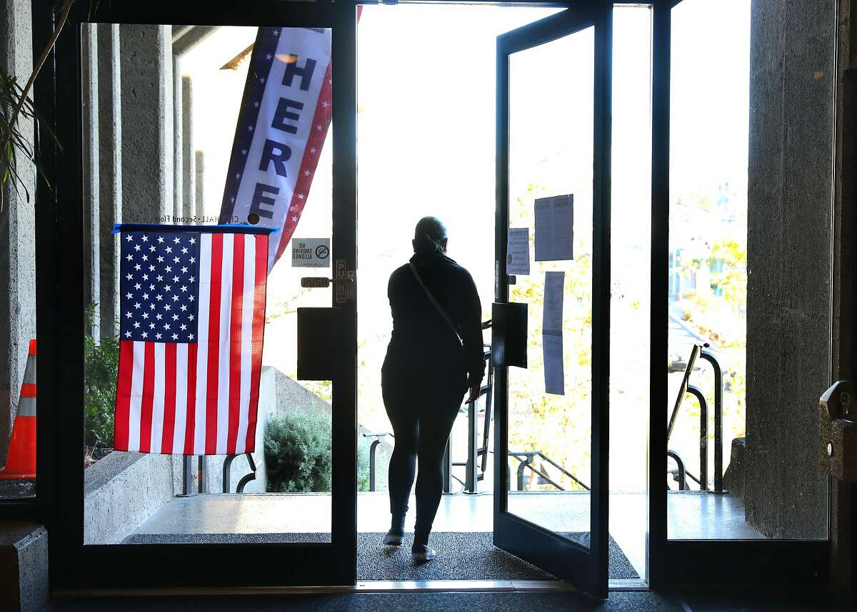 Voter leaves after voting at the Daly City city hall voting center on Tuesday, March 3, 2020, in Daly City, Calif.
