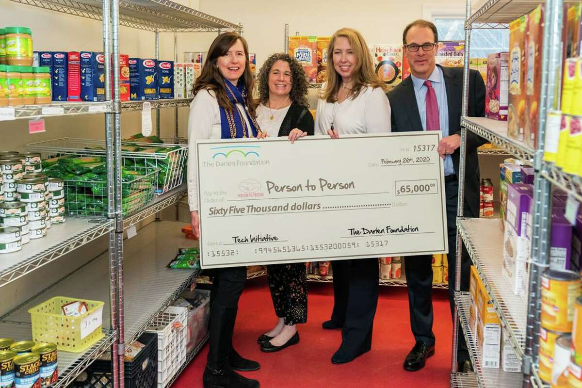 Sarah Woodberry, Executive Director of the Darien Foundation; left, Tracy Cramer, Chief Philanthropy Officer at Person-to-Person; Nancy Coughlin, CEO of Person-to-Person; Ward Glassmeyer, chairman of the Board of Directors of The Darien Foundation