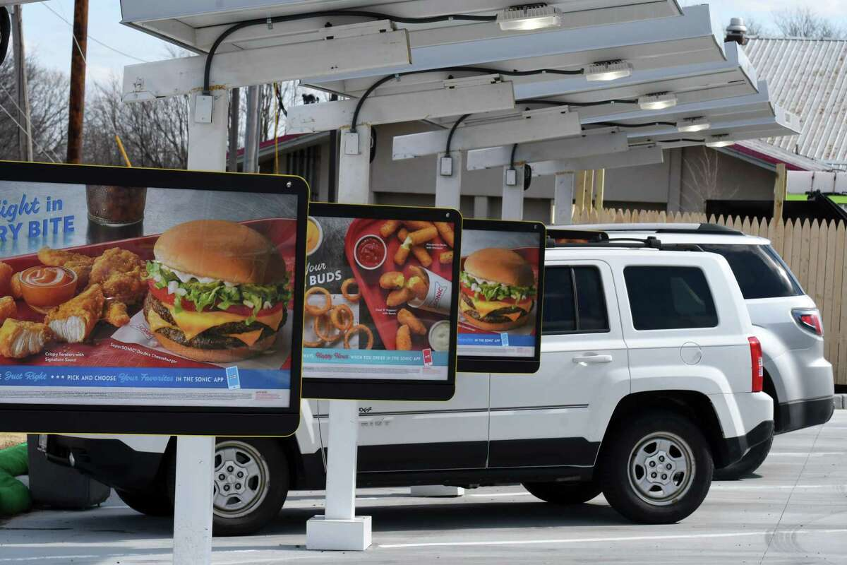Diners order food on opening day for the new Albany Sonic Drive-In on Tuesday, March 3, 2020, at Mt. Hope Commons on Route 9W in Albany, N.Y. (Will Waldron/Times Union)