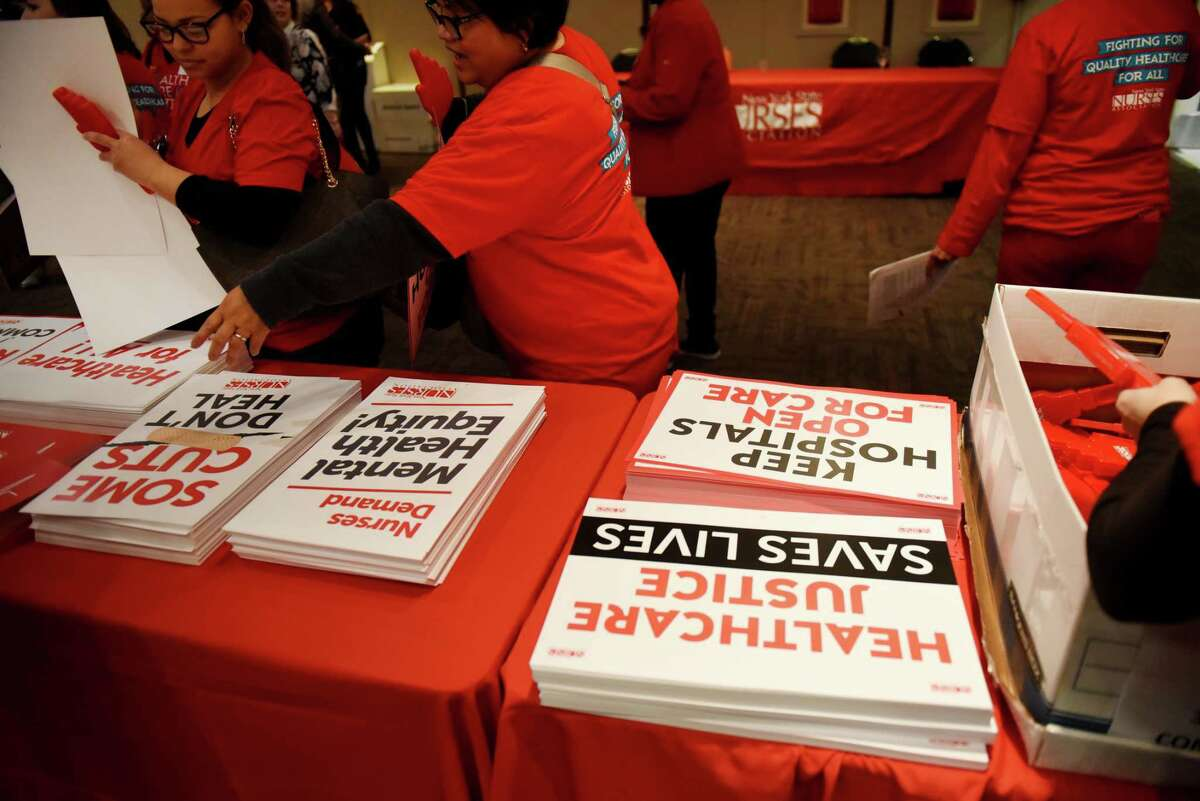 New York State Nurses Association members gather placards for a rally in support of law to enact safer staffing ratios on Tuesday, March 3, 2020, at the Empire State Plaza Convention Center in Albany, N.Y. Healthcare supporters also called for legislators to protect Medicaid funding and other critical healthcare funding for the state. (Will Waldron/Times Union)