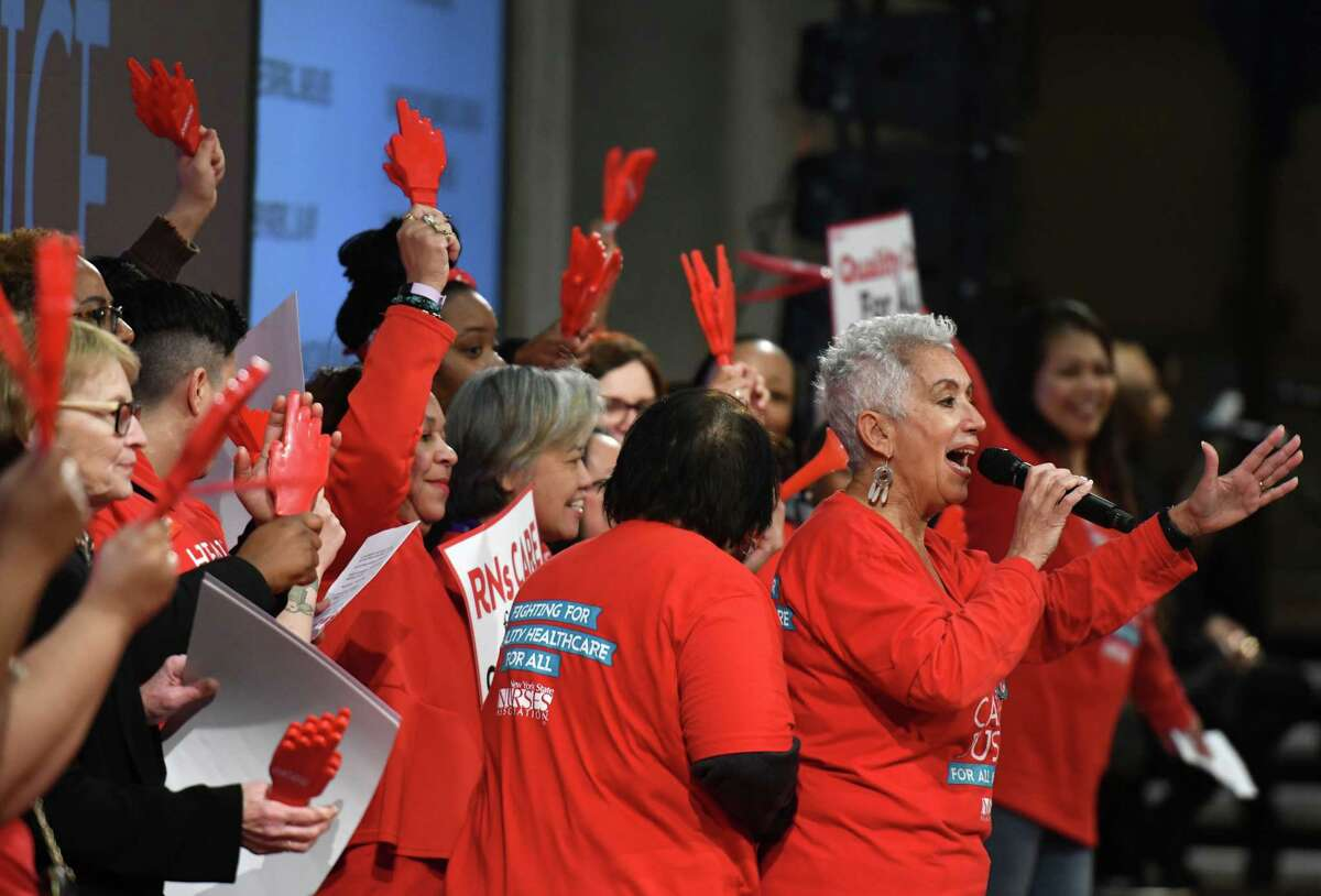New York State Nurses Association members rally in support of law to enact safer staffing ratios on Tuesday, March 3, 2020, at the Empire State Plaza Convention Center in Albany, N.Y. Healthcare supporters also called for legislators to protect Medicaid funding and other critical healthcare funding for the state. (Will Waldron/Times Union)