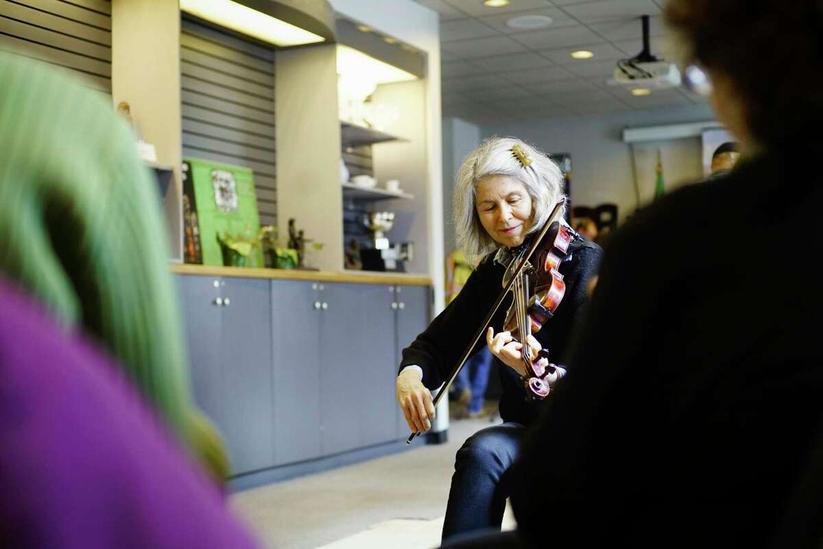 Musician Amy Schoch, with the band Toss the Feathers, plays with a mixed group of musicians from other bands during a press event at the new location of the Irish American Heritage Museum at 25 Quackenbush Square on Tuesday, March 3, 2020, in Albany, N.Y. (Paul Buckowski/Times Union)