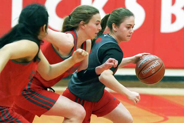 Ella Hartmann gets ahead of defenders in a drill as the Fredericksburg girls basketball team practices on Feb. 2, 2020 for a state finals tournament appearance.