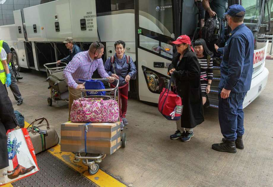 Diamond Princess cruise ship evacuees arrive at the San Antonio International Airport Tuesday after being released from quarantine at JBSA-Lackland. Photo: William Luther /William Luther / ©2020 San Antonio Express-News