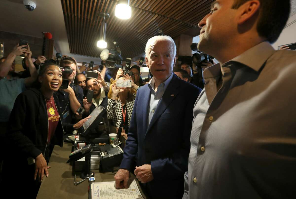 Democratic presidential candidate former Vice President Joe Biden talks with the staff at the Buttercup diner on March 03, 2020 in Oakland, California. Biden's Super Tuesday election night gathering will be held in Los Angeles.