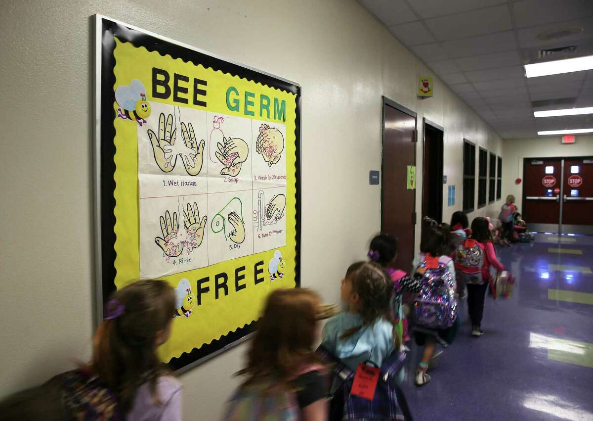 As the coronavirus pandemic loomed in early March, Oak Crest Elementary in East Central ISD posted signs in restrooms and one in the main hallway to remind students about proper hand washing. School districts will be allowed to delay reopening this fall due to the pandemic if local health authorities order it.