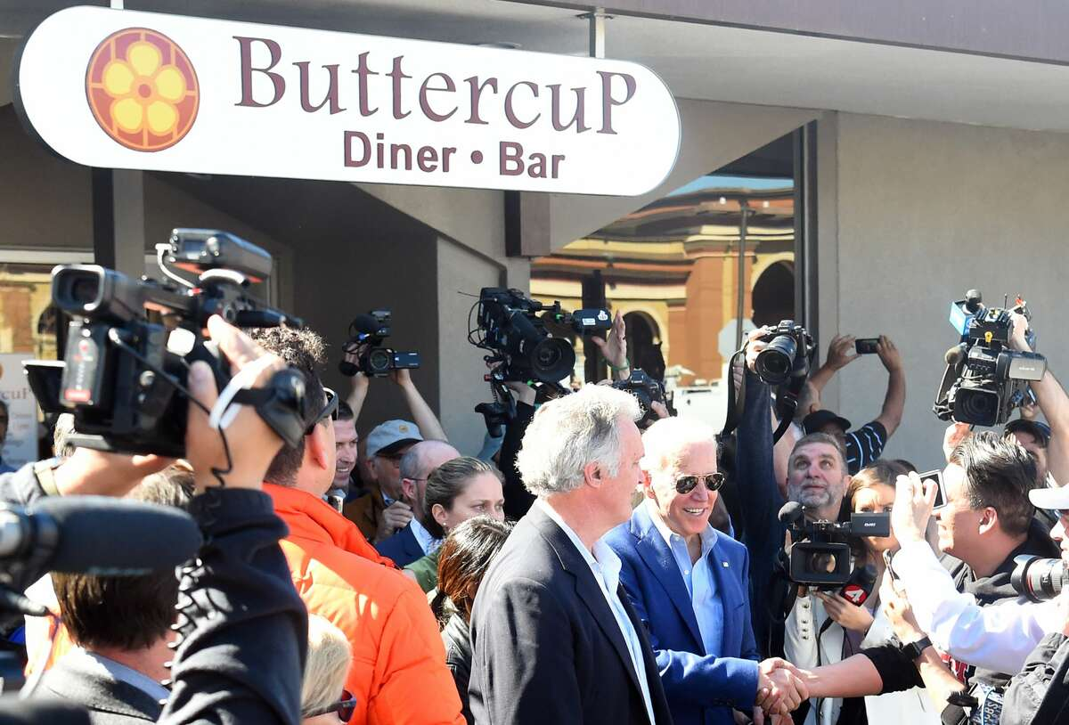 Democratic presidential candidate Joe Biden greets members of the media at Buttercup Diner in Oakland, California on March 03, 2020.