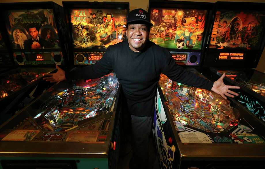 Steve Bowden, one of the world's top pinball players, stands in front of four of the pinball machines in his living room. Bowden moved to San Antonio to work with Deeproot Pinball, a pinball manufacturer set to launch in late March in San Antonio. Photo: Kin Man Hui / **MANDATORY CREDIT FOR PHOTOGRAPHER AND SAN ANTONIO EXPRESS-NEWS/NO SALES/MAGS OUT/ TV OUT