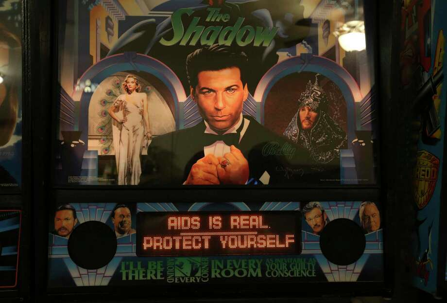 "The message: ""AIDS is real. Protect yourself"" is seen on the screen of a pinball machine owned by Steve Bowden. Photo: Kin Man Hui / **MANDATORY CREDIT FOR PHOTOGRAPHER AND SAN ANTONIO EXPRESS-NEWS/NO SALES/MAGS OUT/ TV OUT"