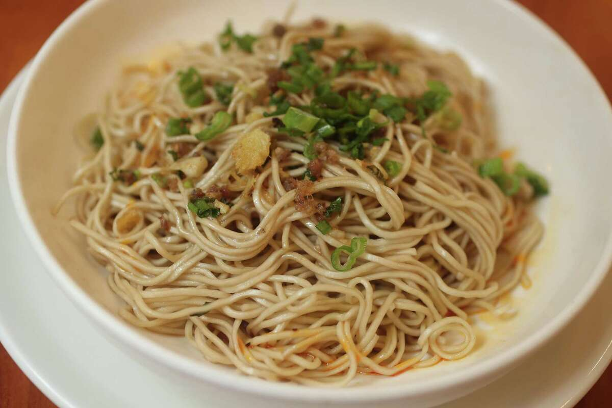 Noodles topped with ground pork, mixed scallion oil, sesame paste and soy sauce at One Dragon
