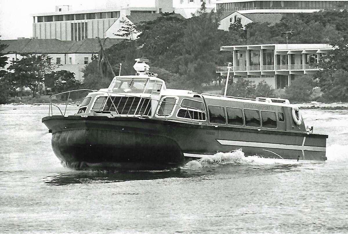 Hovercraft Excalibur flies on Miami River to Miami Seaquarium in 1976.