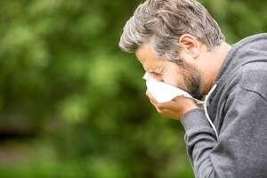 Practicing proper respiratory etiquette can help stop the spread of the coronavirus. This includes wearing a face mask if you have one, sneezing or coughing into a handkerchief, tissue or the crook of you arm, and not standing or speaking too close to others.