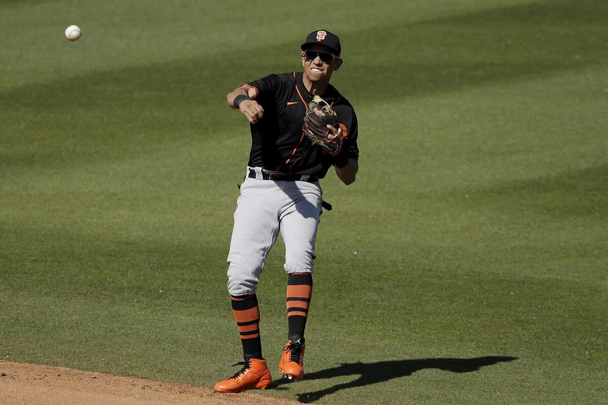 San Francisco Giants second baseman Mauricio Dubon throws during the fourth inning of a spring training baseball game against the San Diego Padres Sunday, March 1, 2020, in Peoria, Ariz. (AP Photo/Charlie Riedel)