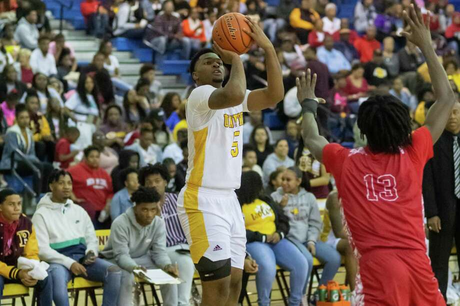 There was no love lost as Beaumont United and North Shore laid it all out in their basketball game on Friday, February 14, 2020, to decide first place in their district. Fran Ruchalski/The Enterprise Photo: Fran Ruchalski/The Enterprise / 2019 The Beaumont Enterprise