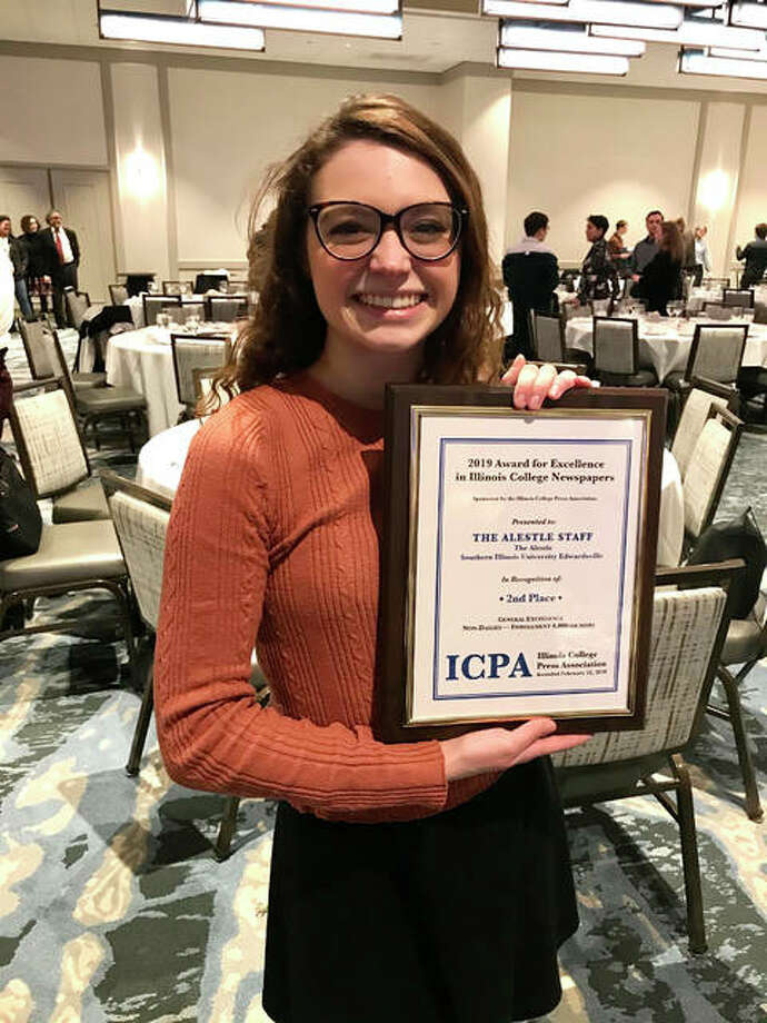 Alestle Editor In Chief Madison Lammert accepts the second-place Illinois College Press Association's General Excellence award in the division for non-daily publications at schools with enrollment higher than 4,000. Half of ICPA member publications compete in this division. Photo: Courtesy Of The Alestle