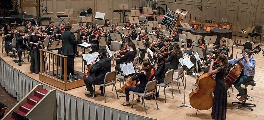 Members of the Staples High School Chamber Orchestra, on a recent trip to Boston, play on the stage of Symphony Hall as part of a master class with a Boston Symphony musician in 2016. Photo: Contributed / Contributed Photo / Westport News