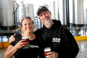 Claudia Pamparana and her husband Rodger Davis, owners of Faction Brewing in Alameda, Calif., on Saturday, April 25, 2015.