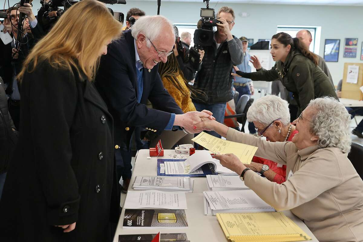 *** BESTPIX *** BURLINGTON, VERMONT - MARCH 03: Democratic presidential candidate Sen. Bernie Sanders (I-VT) and his wife Jane O'Meara Sanders greet poll workers before voting in their state's primary election at the Robert Miller Community Center March 03, 2020 in Burlington, Vermont. Voters in 14 states are going to the polls on Super Tuesday. (Photo by Chip Somodevilla/Getty Images)