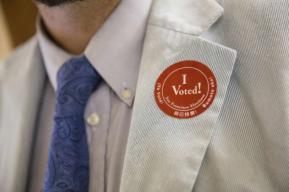 """A man wears an """"I Voted!"""" sticker after voting in the California primary on June 7, 2016, at City Hall in San Francisco. Photo: Andrew Burton/Getty Images"""