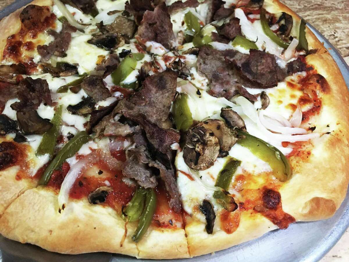 The steak and cheese pizza at Chicago's Pizza with the hand-tossed crust is served with the traditional ingredients of a Philly cheesesteak.