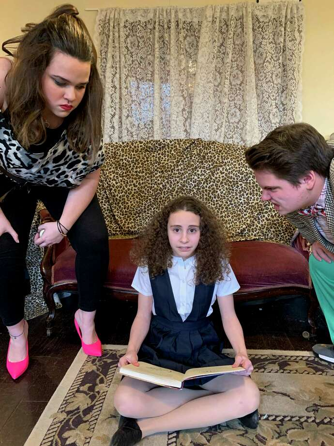 Kidz Konnection will present Roald Dahl's beloved classic story adapted into the musical, Matilda, performs on the Clinton Town Hall Stage March 13 - 15. Above, Skyler Lane as Mrs. Wormwood, Morgan Cheslock as Matilda, and Will Curry as Mr. Wormwood. Photo: Kidz Konnection / Contributed Photo /