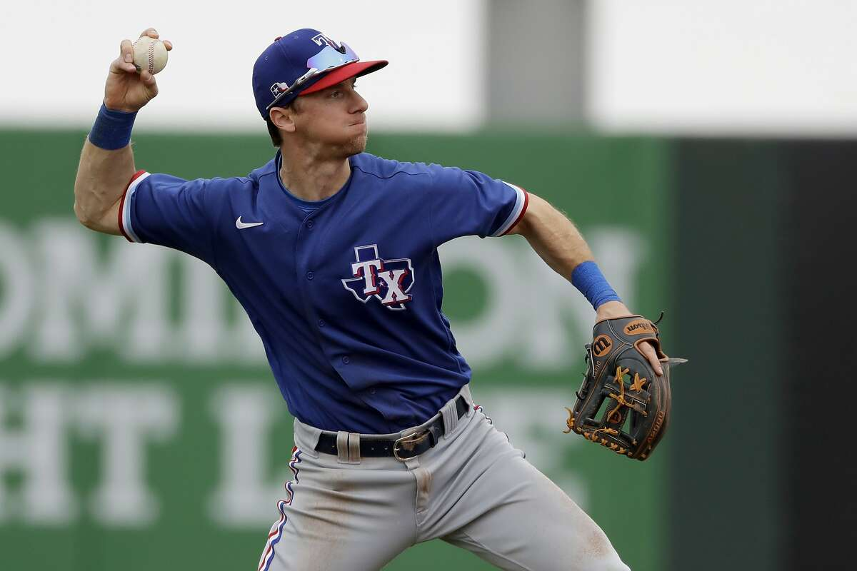 Texas Rangers shortstop Matt Duffy throws during the second inning of a spring training baseball game against the Los Angeles Angels Friday, Feb. 28, 2020, in Tempe, Ariz. (AP Photo/Charlie Riedel)