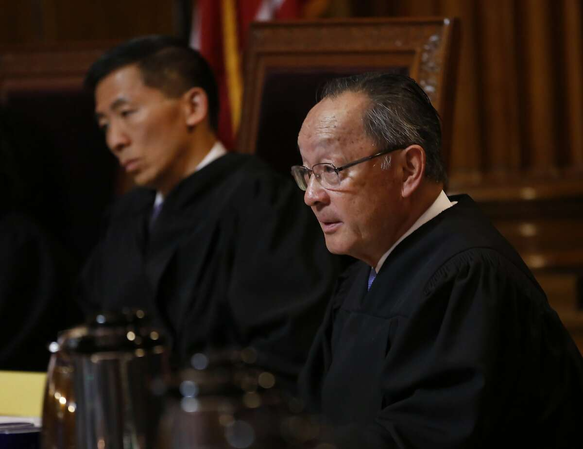 California Supreme Court Associate Justice Ming Chin, right, questions Deputy Attorney General Jay Russell, unseen, about the state's arguments opposing a lawsuit filed by the California Republican Party to overturn a recently approved state law requiring presidential candidates to disclose their tax returns in order to be of the state's primary ballot, in Sacramento, Calif., Wednesday, Nov. 6, 2019. The law, if upheld, is intended to force President Donald Trump to release his tax returns before California's primary election that will be held in March 2020. (AP Photo/Rich Pedroncelli, Pool)