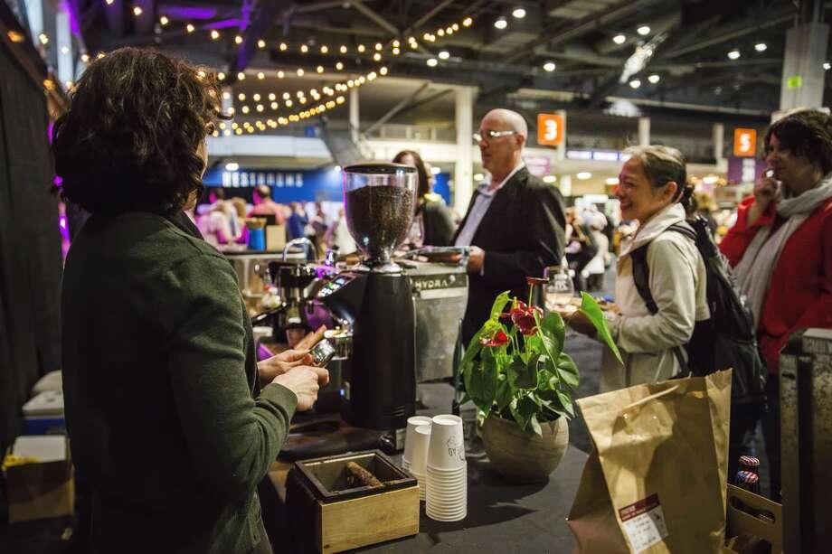 Guests peruse through displays courtesy of Washington's winemakers and chefs. Photo: Suzi Pratt