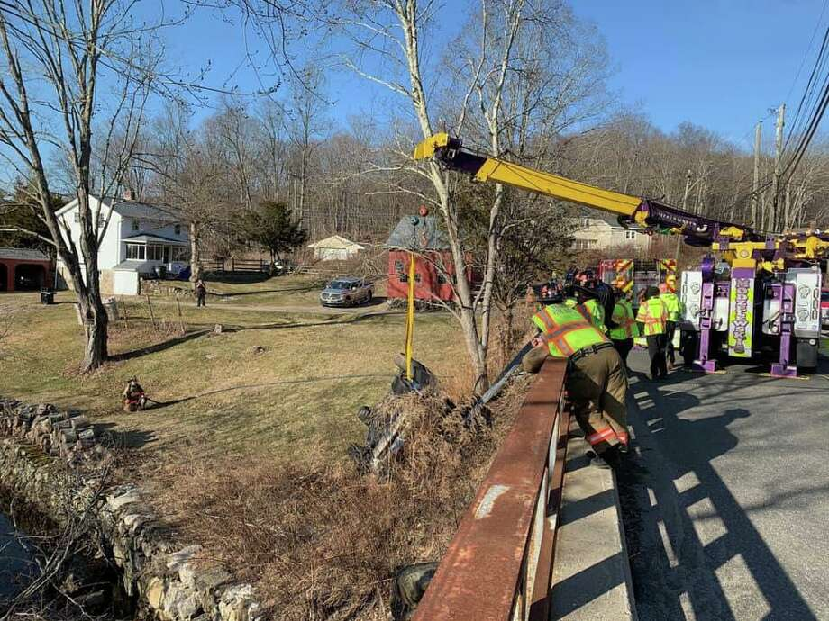 First responders on scene for a rollover in the area of Hogs Back Road and Oxford Road in Oxford, Conn., on Monday, March 2, 2020. Photo: Contributed Photo / Oxford Fire-Rescue