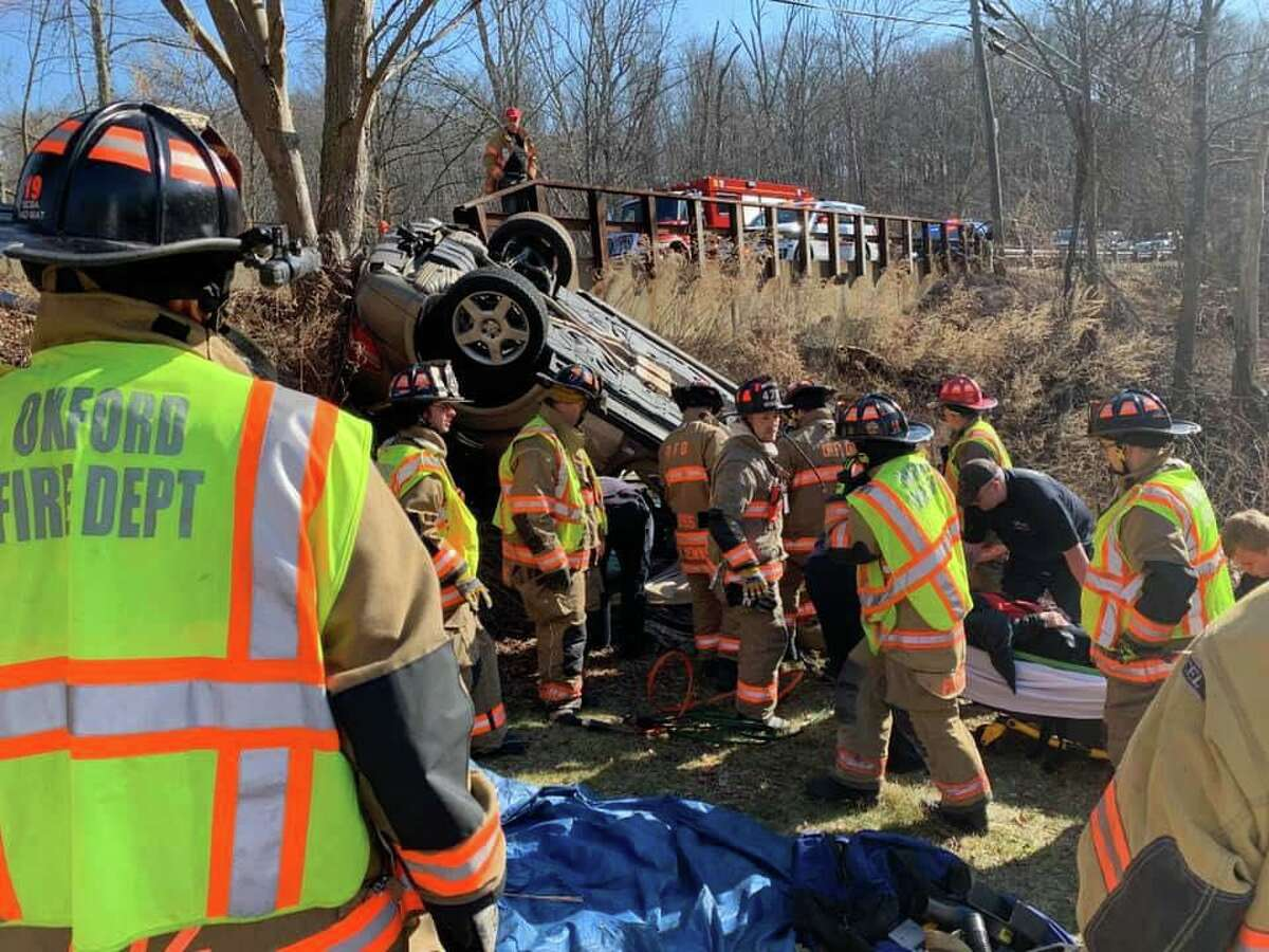 First responders on scene for a rollover in the area of Hogs Back Road and Oxford Road in Oxford, Conn., on Monday, March 2, 2020.