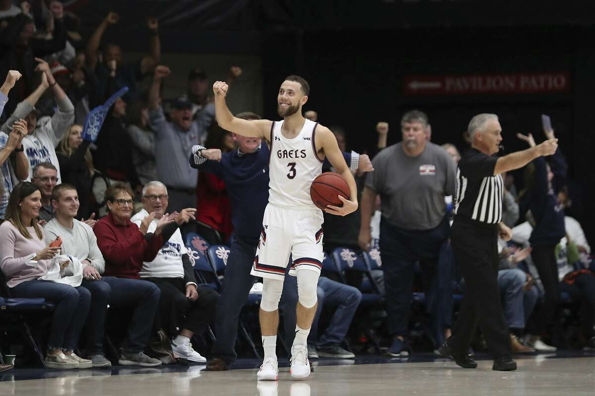 Saint Mary's guard Jordan Ford (3) celebrates after the team defeated Utah State during an NCAA college basketball game in Moraga, Calif., Friday, Nov. 29, 2019. (AP Photo/Jed Jacobsohn)