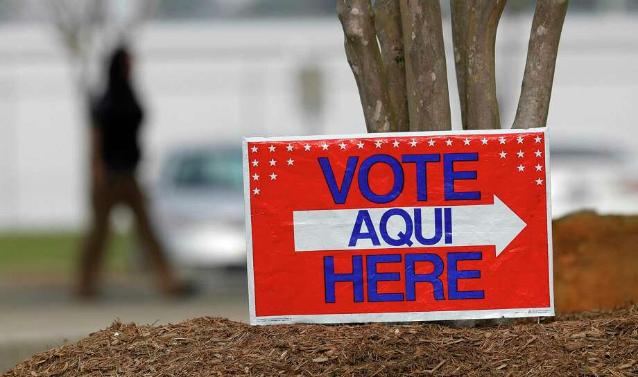 A voting sign directs residents to the polling location at the North Montgomery County Community Center on Election Day during Feb. 3, 2020, in Willis. Photo: Jason Fochtman, Houston Chronicle / Staff Photographer / Houston Chronicle  © 2020