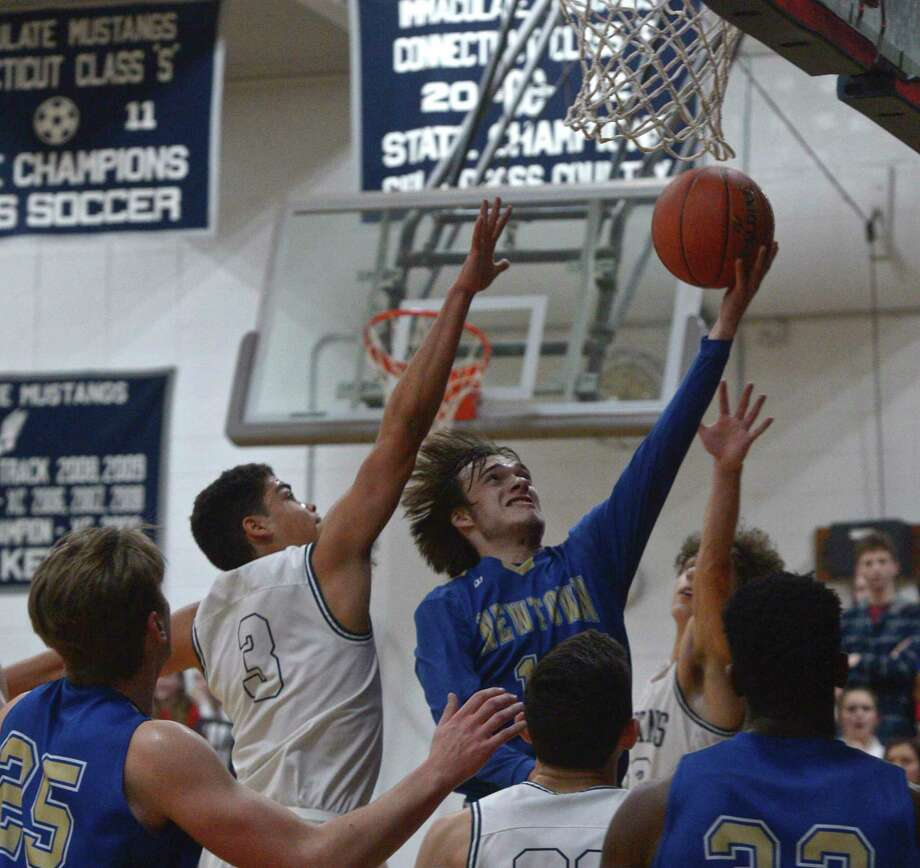 Newtown's Riley Ward (10) drives to the basket past Immaculate's Diego Echavarria (3) in the SWC boys basketball semifinal between No.4 Newtown and No.1 Immaculate, Tuesday night, March 3, 2020, at Immaculate High School, Danbury, Conn. Photo: H John Voorhees III / Hearst Connecticut Media / The News-Times