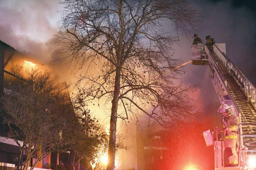 A two-alarm fire raged through an apartment building Friday night on the North Side. Joe Arrington, spokesman for the San Antonio Fire Department, said the third floor was fully engulfed when firefighters arrived at Altitude Apartment Homes in the 5200 block of Fredericksburg Road. The fire was contained to one building at the complex, destroying it, firefighters said. Firefighters remained on the scene Friday night.