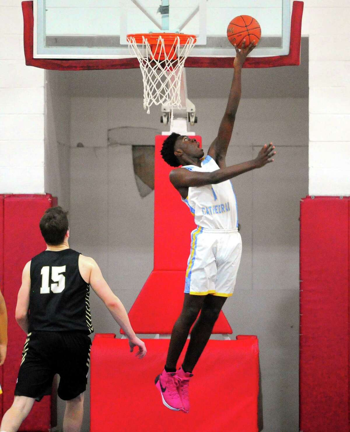 Kolbe Cathedral's Da'shawn Hall-Jonson (1) slips the ball to the basket during SWC boys basketball semifinal action against Joel Barlow in Bridgeport, Conn., on Tuesday Mar. 3, 2020.