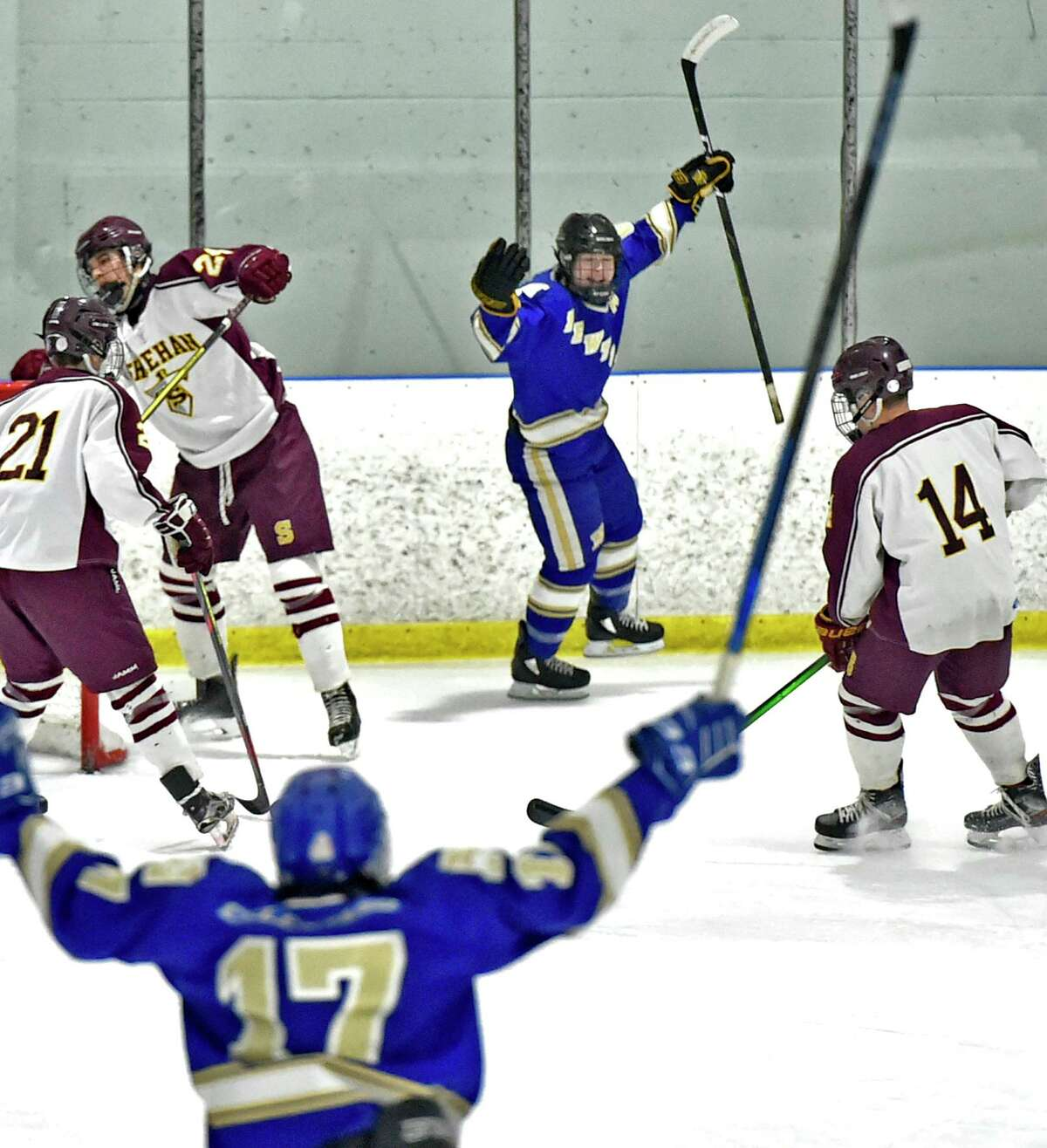 Newtown's Philip Makris, center rear, celebrates his goal against Sheehan H.S. during the first period of the SCC/SWC 2020 Boys Ice Hockey Division III semifinals Tuesday evening at the Milford Ice Arena in Milford.