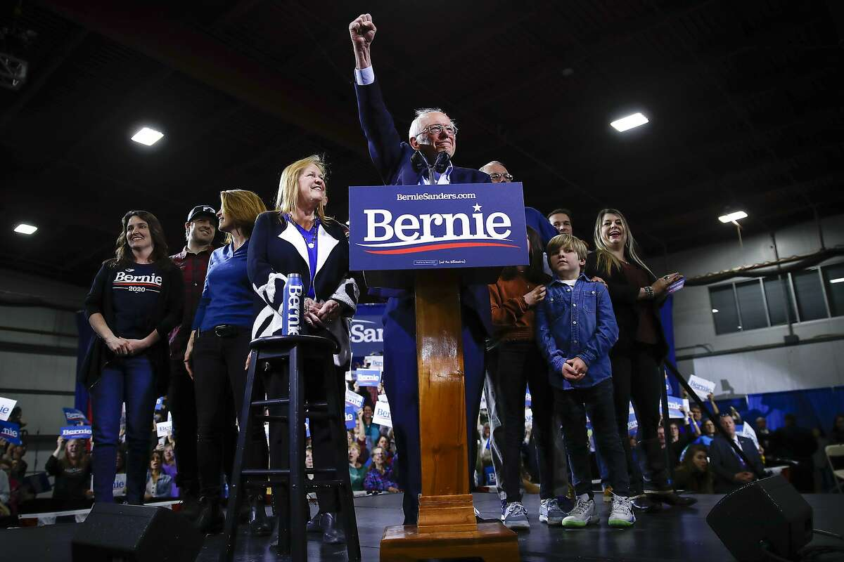 Democratic presidential candidate Sen. Bernie Sanders, I-Vt., accompanied by his wife Jane O'Meara Sanders and other family members speaks during a primary night election rally in Essex Junction, Vt., Tuesday, March 3, 2020. (AP Photo/Matt Rourke)