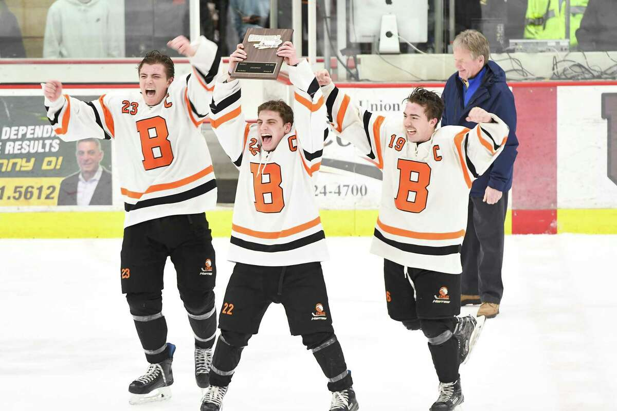 Bethlehem captains Jonathan Thibodeau (23), Justin Chenaille (22) and Ben LaVigne hoist up the Section II Champions plaque after winning the Division 1 Sectional Championship against Saratoga at Union College in Schenectady, N.Y., Tuesday, Mar. 3, 2020. (Jenn March, Special to the Times Union)