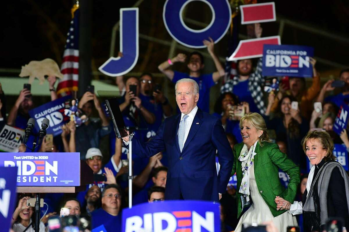Democratic presidential hopeful former Vice President Joe Biden (L) arrives onstage with his wife Jill and sister Valerie (R) for a Super Tuesday event in Los Angeles on March 3, 2020. (Photo by FREDERIC J. BROWN / AFP) (Photo by FREDERIC J. BROWN/AFP via Getty Images)