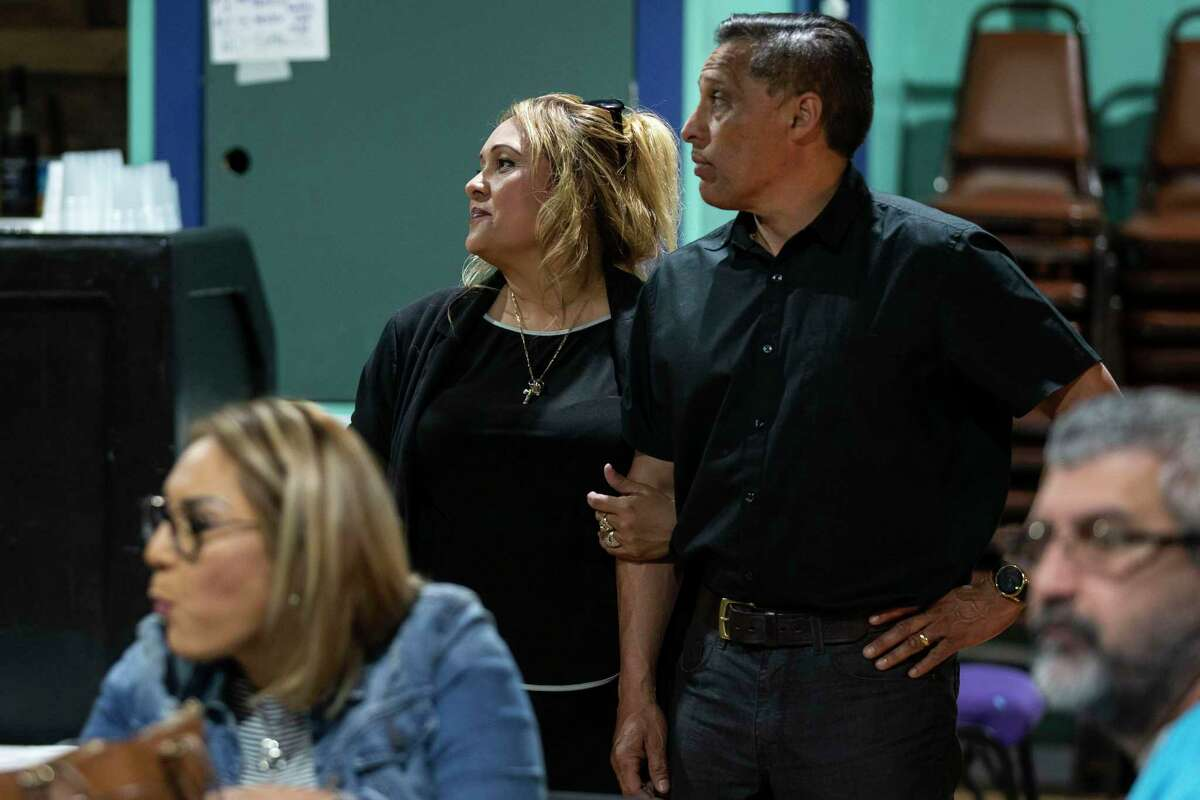 Bexar County Sherif candidate and former Constable Michelle Barrientes Vela stands with her husband Carlos Vela as they wait for numbers to come in during her election night gathering held at Tha1Media Hub in San Antonio, Texas, on March 3, 2020. Barrientes Vela accidentally gave up her elected office when she announced she was running for sheriff too early and was recently indicted on perjury, oppression and falsifying evidence charges.