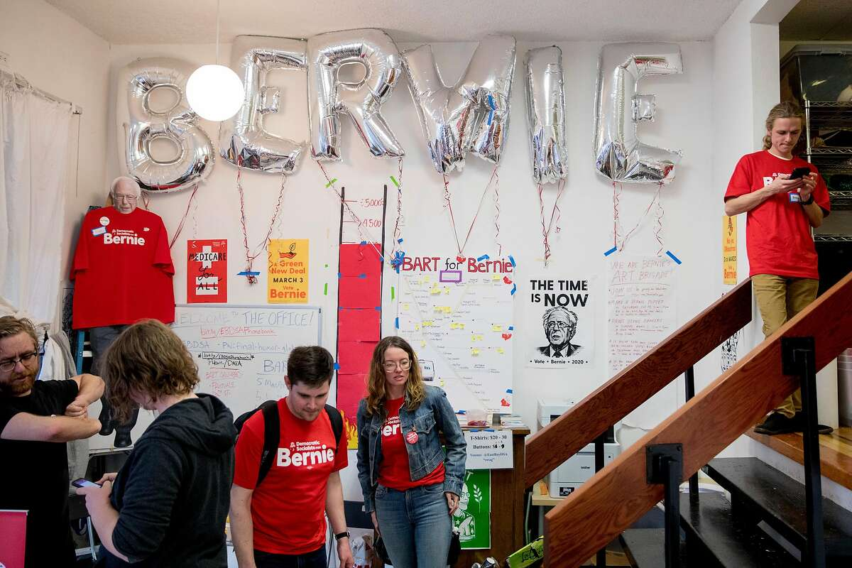 Members of Democratic Socialists of America East Bay Chapter gather to campaign for Democratic presidential candidate Bernie Sanders during California's primary Election Day at their East Bay headquarters in Oakland, Calif. Tuesday, March 3, 2020.